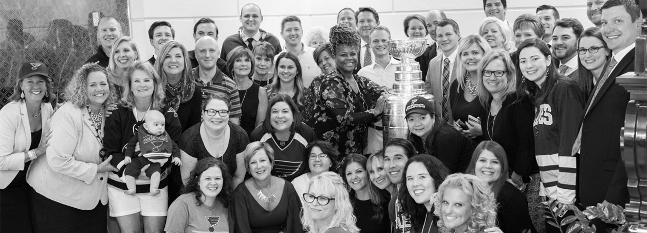 All Parkside employees pose together for a group photo with the Stanley Cup!